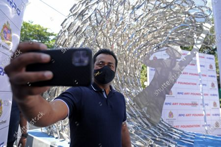 Stock Picture of Tennis legend Leander Paes taking selfie in front of 'Waves' an art installation by artist Krishna Kedar at Bandra, on December 28, 2020 in Mumbai, India.