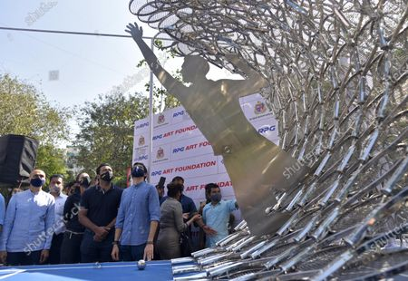 Stock Photo of Maharashtra Minister of Tourism and Environment Aditya Thackeray and tennis legend Leander Paes during an inauguration of 'Waves' an art installation by artist Krishna Kedar at Bandra, on December 28, 2020 in Mumbai, India.