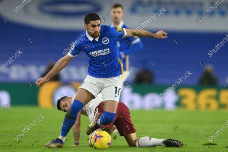 Brighton's Alireza Jahanbakhsh challenges for the ball with Arsenal's Granit Xhaka the English Premier League soccer match between Brighton and Arsenal at the Falmer stadium in Brighton, England