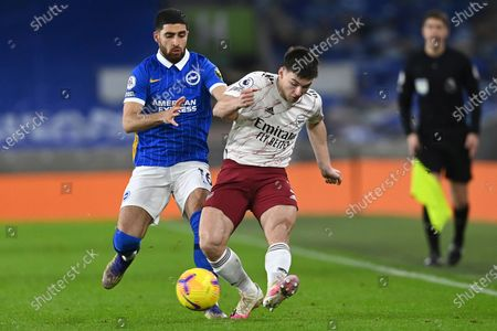 Brighton's Alireza Jahanbakhsh, left, challenges for the ball with Arsenal's Kieran Tierney during the English Premier League soccer match between Brighton and Arsenal at the Falmer stadium in Brighton, England