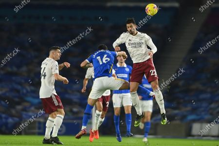 Arsenal's Pablo Mari, right, jumps for a header with Brighton's Alireza Jahanbakhsh the English Premier League soccer match between Brighton and Arsenal at the Falmer stadium in Brighton, England