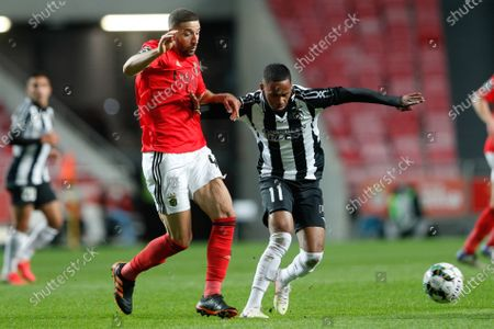 Stock Photo of Benfica's player Adel Taarabt (L) in action against Portimonense player Anderson Silva during the Portuguese First League soccer match against Portimonense held at Luz Stadium, Lisbon, Portugal, 29 December 2020.