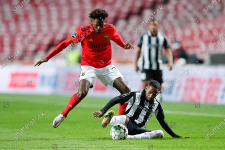 Stock Image of Benfica's player Nuno Tavares (L) in action against Portimonense player Anderson Silva  during the Portuguese First League soccer match against Portimonense held at Luz Stadium, Lisbon, Portugal, 29 December 2020.