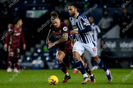 Matt Phillips of West Bromwich Albion takes on Kalvin Phillips of Leeds United