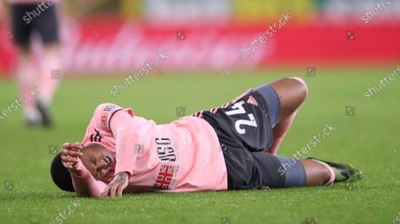 Sheffield United's Rhian Brewster lies on the pitch in pain during the English Premier League soccer match between Burnley and Sheffield United at the Turf Moor stadium in Burnley, England