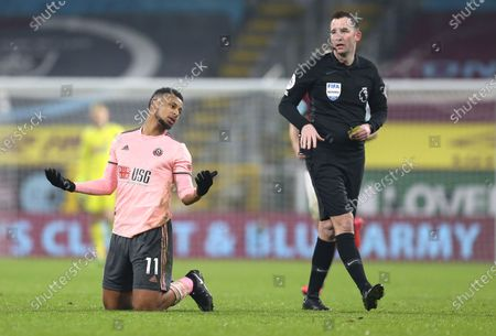 Sheffield United's Lys Mousset reacts as referee Chris Kavanagh passes by during the English Premier League soccer match between Burnley and Sheffield United at the Turf Moor stadium in Burnley, England
