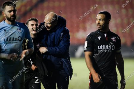 Scunthorpe United manager Neil Cox congratulates Scunthorpe United George Hornshaw (44) during the EFL Sky Bet League 2 match between Walsall and Scunthorpe United at the Banks's Stadium, Walsall