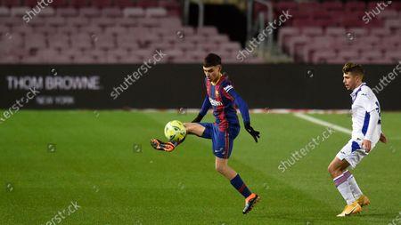 Pedro Gonzalez Pedri of FC Barcelona and Alejandro Pozo of SD Eibar