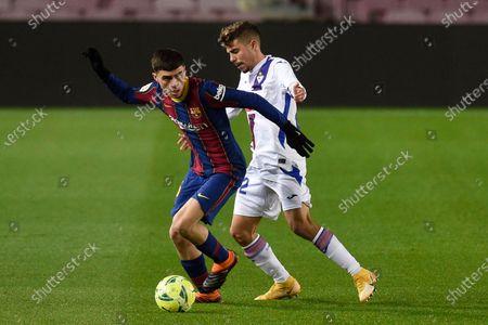 Stock Photo of Pedro Gonzalez Pedri of FC Barcelona and Alejandro Pozo of SD Eibar