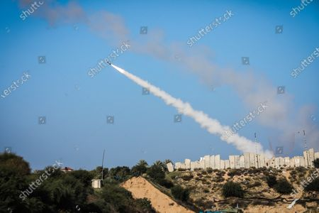 """A rocket seen fired into the Mediterranean Sea during a military drill in Gaza City. Palestinian factions held a military exercise in the blockaded Gaza Strip. The groups say the training aims to """"enhance the efficiency and combat readiness of fighters to be able to fight in all different conditions."""" All armed wings of the Gaza-based factions are taking part in the drill, except the military arm of Palestinian President Mahmoud Abbas' Fatah movement. """"The exercise comes as part of efforts to boost the joint action and cooperation between the military wings of the Palestinian factions,"""" Abu Hamza, a spokesman for Saraya al-Quds Brigades, the armed wing of Islamic Jihad group, told a news conference in Gaza City."""