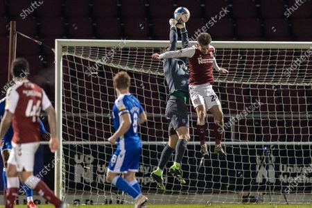 Gillingham FC goalkeeper Jack Bonham (1) saves from Northampton Town Forward Danny Rose (29) during the EFL Sky Bet League 1 match between Northampton Town and Gillingham at the PTS Academy Stadium, Northampton