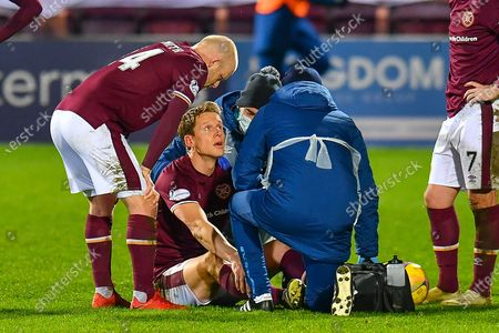 Christophe Berra (#6) of Heart of Midlothian FC looks dazed after a heard knock during the SPFL Championship match between Heart of Midlothian and Arbroath at Tynecastle Park, Edinburgh