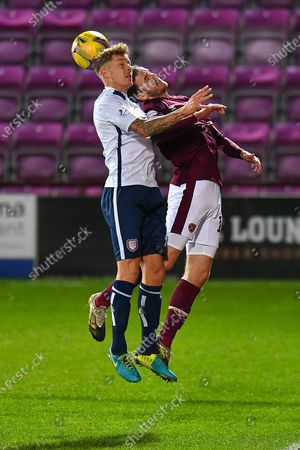 Stock Picture of David Gold (#7) of Arbroath FC and Andy Halliday (#16) of Heart of Midlothian FC compete for a header during the SPFL Championship match between Heart of Midlothian and Arbroath at Tynecastle Park, Edinburgh
