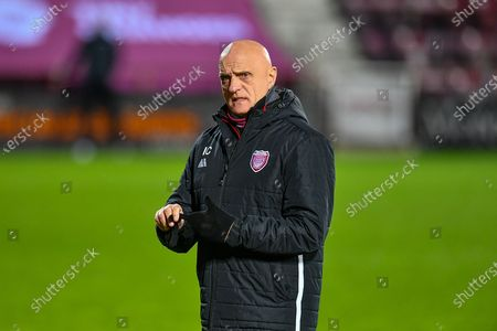Arbroath FC assistant manager, Ian Campbell watches his team warm up before the SPFL Championship match between Heart of Midlothian and Arbroath at Tynecastle Park, Edinburgh