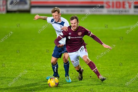 Stock Image of David Gold (#7) of Arbroath FC tries to pull back Andy Halliday (#16) of Heart of Midlothian FC during the SPFL Championship match between Heart of Midlothian and Arbroath at Tynecastle Park, Edinburgh