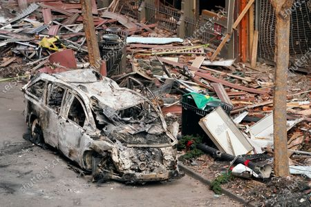 Vehicle destroyed in a Christmas Day explosion remains on the street, in Nashville, Tenn. Officials have named 63-year-old Anthony Quinn Warner as the man behind the bombing in which he was killed, but his motive remains elusive