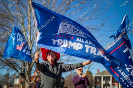 US President Donald J. Trump supporter Gary White waves his flags as Republican Senator from Georgia Kelly Loeffler participates in a campaign event in Woodstock, Georgia, USA, 29 December 2020. Loeffler is running against Democrat challenger Reverend Raphael Warnock in a 05 January 2021 runoff election.