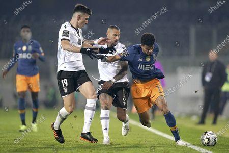 Vitoria de Guimaraes's Pepelu (L) and Ricardo Quaresma (C) in action against FC Porto's Luis Diaz during their Portuguese First League soccer match held in Guimaraes, Portugal, 29 December 2020.