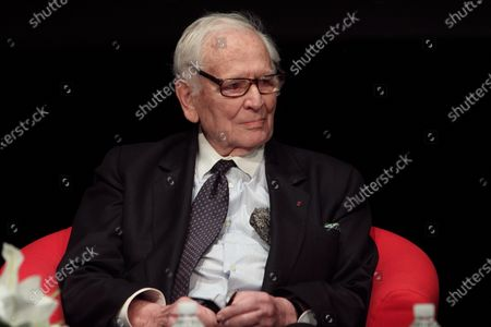 Stock Image of **FILE PHOTO** Pierre Cardin Has Passed Away at 98.MADRID, SPAIN - APRIL 07: Italian-born French fashion designer Pierre Cardin speaks with his fashion director Maryse Gaspard during a conference entitled 'Pierre Cardin's scenic projection' at the French Institute on April 7, 2014 in Madrid, Spain
