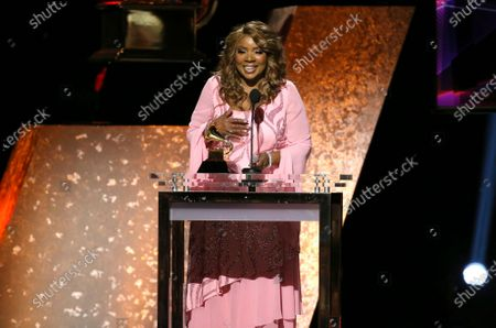 """Gloria Gaynor accepts the award for best roots gospel album for """"Testimony"""" at the 62nd annual Grammy Awards in Los Angeles. Gaynor will perform """"I Will Survive"""" during a much scaled down 2020 New Year's Eve celebration in New York's Times Square"""