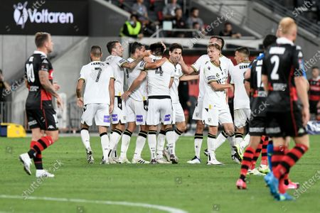Benat Etxebarria Urkiaga of Macarthur FC celebrates with teammates after scoring to make it 1-0 in the 73rd minute , the goal was later credited to Mark Milligan; Bankwest Stadium, Parramatta, New South Wales, Australia; A League Football, Western Sydney Wanderers versus Macarthur FC.