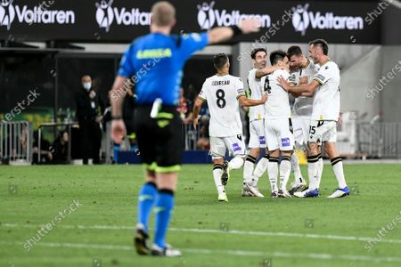 Benat Etxebarria Urkiaga of Macarthur FC celebrates with teammates after scoring to make it 1-0 in the 73rd minute as referee Kurt Ams signals the goal, the goal was later credited to Mark Milligan; Bankwest Stadium, Parramatta, New South Wales, Australia; A League Football, Western Sydney Wanderers versus Macarthur FC.