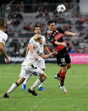 Graham Dorrans of Western Sydney Wanderers wins a header from Lachlan Rose of Macarthur; Bankwest Stadium, Parramatta, New South Wales, Australia; A League Football, Western Sydney Wanderers versus Macarthur FC.