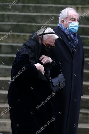 Michele Cambon, Christian Cambon attend during the mass in homage to Claude Brasseur at Church of Saint Roch