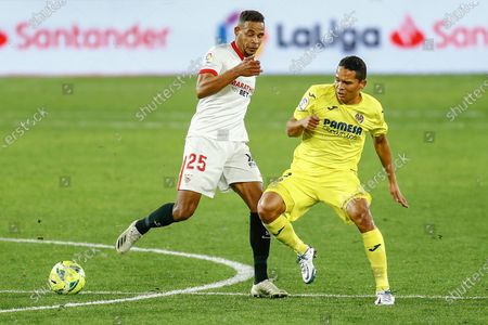 Fernando Reges of Sevilla FC and Carlos Bacca of Villarreal CF