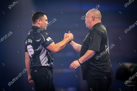 Gerwyn Price (Wales) congratulated by Mervyn King (Englan) during the Fourth Round of the William Hill World Darts Championship at Alexandra Palace, London