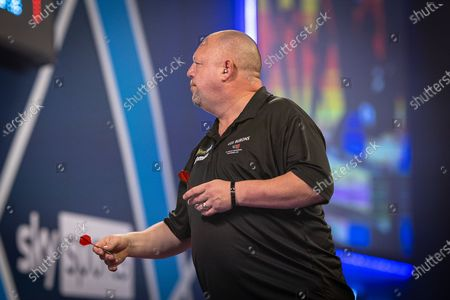 Mervyn King  (England), ear plug visible, during the Fourth Round of the William Hill World Darts Championship at Alexandra Palace, London
