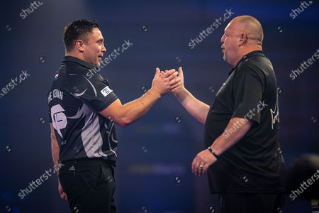 Gerwyn Price (Wales) congratulated by Mervyn King (England) during the Fourth Round of the William Hill World Darts Championship at Alexandra Palace, London