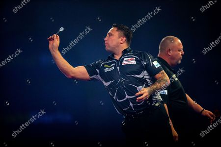 Gerwyn Price (Wales), Mervyn King (England), reacts during the Fourth Round of the William Hill World Darts Championship at Alexandra Palace, London
