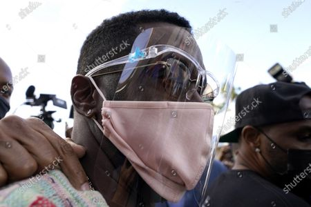 """Stock Image of Rapper Sean """"Diddy"""" Combs in the Overtown neighborhood of Miami, where he passed out fifty dollar bills to residents, . Various organizations came together to also pass out gift cards and gift bags with essentials to those in need during the coronavirus pandemic"""
