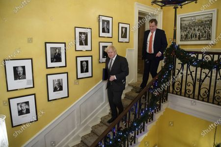UK chief trade negotiator David Frost, right, follows Prime Minister Boris Johnson after signing the EU-UK Trade and Cooperation Agreement at 10 Downing Street, London . The U.K. left the EU almost a year ago, but remained within the bloc's economic embrace during a transition period that ends at midnight Brussels time -- 11 p.m. in London - on Thursday. European Commission President Ursula von der Leyen and European Council President Charles Michel signed the agreement during a brief ceremony in Brussels on Wednesday morning then the documents were flown by Royal Air Force plane to London for Johnson to add his signature
