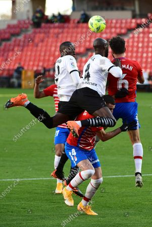 Stock Picture of Granada's Maxime Gonalons (C) fights for the ball with Valencia's Eliaquim Mangala (4C) during their Spanish LaLiga Primera Division soccer match held at the Nuevo Los Carmenes stadium, in Granada, southern Spain, on 30 December 2020.