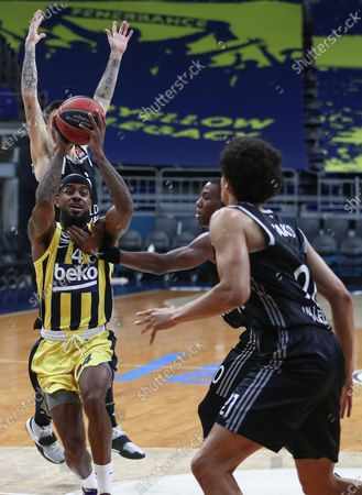 Fenerbahce's  Lorenzo Brown (L) in action against Villeurbanne's  Norris Cole  (R) during the EuroLeague basketball match between Fenerbahce  and Asvel Villeurbanne  in Istanbul, Turkey 30 December  2020.