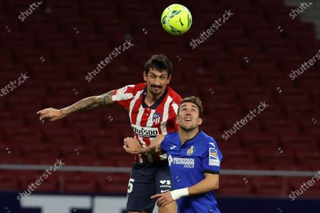 Stock Image of Atletico Madrid's Stefan Savic (L) heads for the ball with Getafe CF's Francisco Portillo (R) during their Spanish LaLiga Primera Division soccer match played at Wanda Metropolitano stadium, in Madrid, Spain, on 30 December 2020.