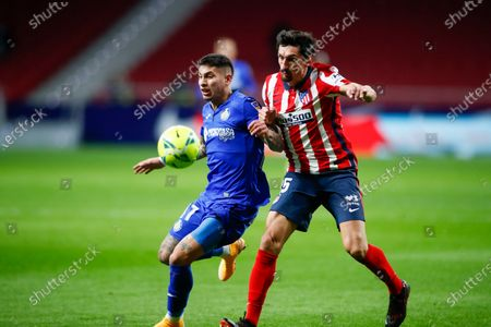 Mathias Olivera of Getafe and Stefan Savic of Atletico de Madrid in action during the spanish league, La Liga Santander, football match played between Atletico de Madrid and Getafe CF at Wanda Metropolitano stadium on december 30, 2020, in Madrid, Spain