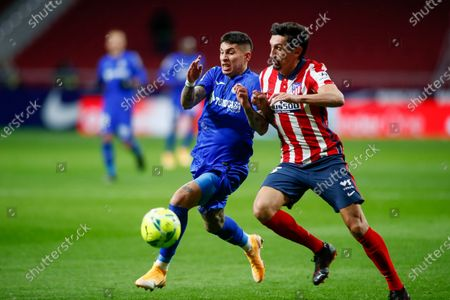 Stock Picture of Mathias Olivera of Getafe and Stefan Savic of Atletico de Madrid in action during the spanish league, La Liga Santander, football match played between Atletico de Madrid and Getafe CF at Wanda Metropolitano stadium on december 30, 2020, in Madrid, Spain