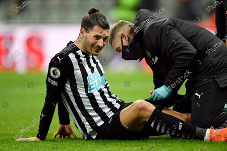 Newcastle's Fabian Schar (L) receives medical treatment in during the English Premier League soccer match between Newcastle United and Liverpool in Newcastle, Britain, 30 December 2020.