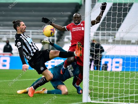 Newcastle's Fabian Schar (L) in action against Liverpool's Sadio Mane (R) during the English Premier League soccer match between Newcastle United and Liverpool in Newcastle, Britain, 30 December 2020.