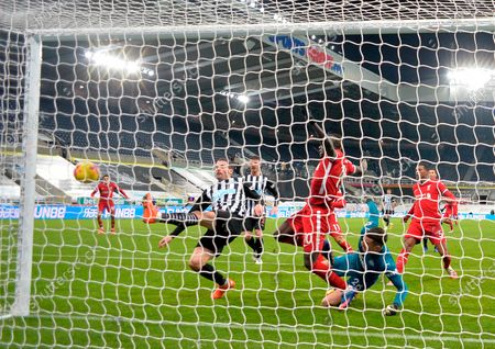 Newcastle's Fabian Schar (L) in action against Liverpool's Sadio Mane (C) during the English Premier League soccer match between Newcastle United and Liverpool in Newcastle, Britain, 30 December 2020.