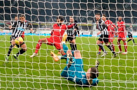 Liverpool's Mohamed Salah (C) in action against Newcastle's DeAndre Yedlin (L) during the English Premier League soccer match between Newcastle United and Liverpool in Newcastle, Britain, 30 December 2020.