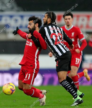 Liverpool's Mohamed Salah (L) in action against Newcastle's DeAndre Yedlin (R) during the English Premier League soccer match between Newcastle United and Liverpool in Newcastle, Britain, 30 December 2020.