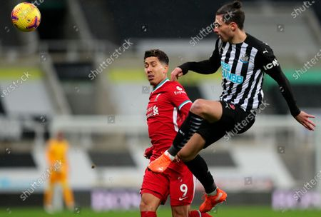 Newcastle's Fabian Schar (R) in action against Liverpool's Roberto Firmino (L) during the English Premier League soccer match between Newcastle United and Liverpool in Newcastle, Britain, 30 December 2020.