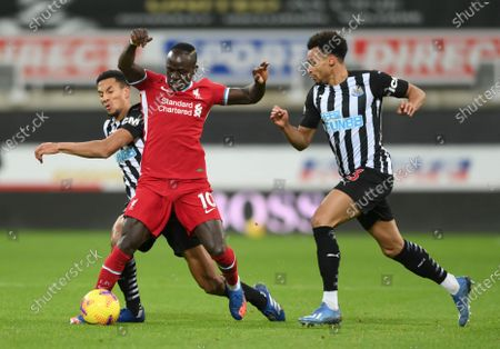 Liverpool's Sadio Mane shields the ball during the English Premier League soccer match between Newcastle United and Liverpool at St James' Park stadium in Newcastle, England