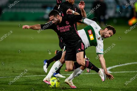 Elche's Lucas Boye duels for the ball with Real Madrid's Dani Carvajal, foreground, during the Spanish La Liga soccer match between Real Madrid and Elche CF at the Manuel Martinez Valero stadium in Elche, Spain