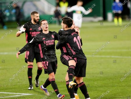 Real Madrid's Croatian Luka Modric (2-R) celebrates with teammates after scoring the opening goal against Elche during their Spanish LaLiga Primera Division soccer match played at the Martinez Valero stadium, in Elche, eastern Spain, on 30 December 2020.