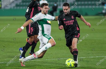Lucas Boye of Elche CF and Dani Carvajal of Real Madrid CF in action during La Liga football match played between Elche CF and Real Madrid CF at Martinez Valero stadium on December 30, 2020 in Elche, Alicante, Spain.